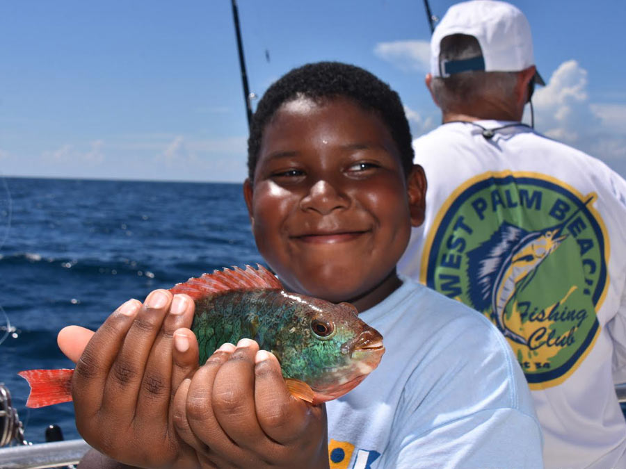 happy kid holding fish