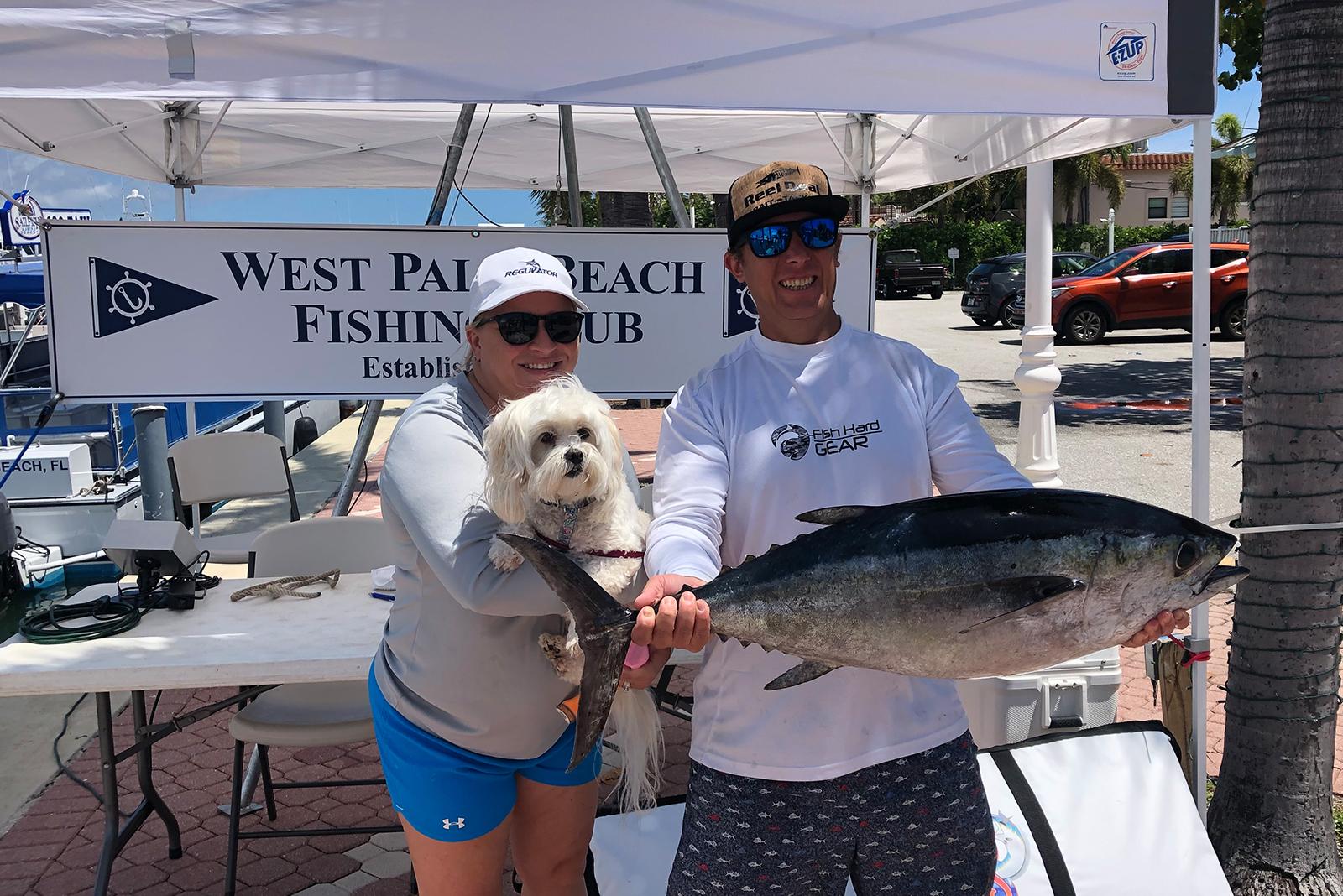 anglers holding tuna