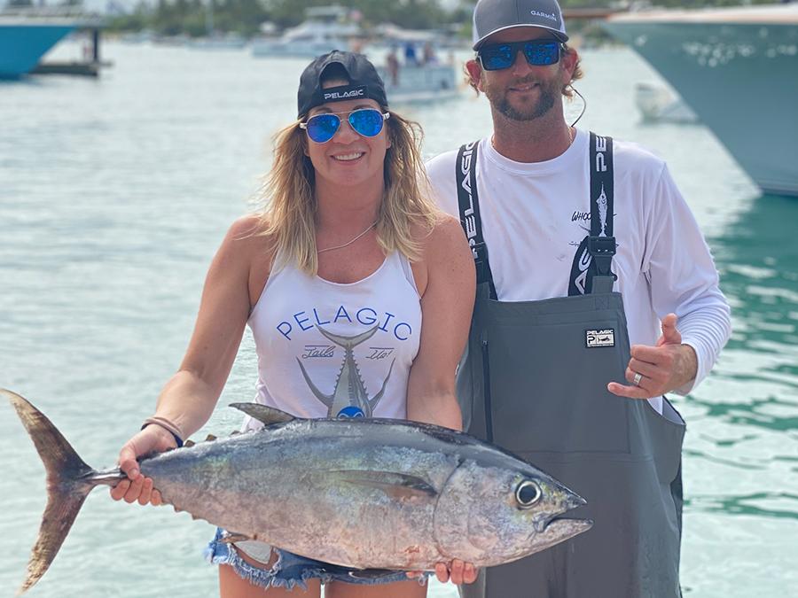 lady angler holding a tuna